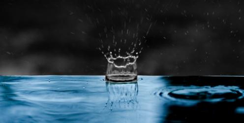 Drop of rain water creates a splash